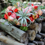 April bridal bouquet on the wood pile at the farm