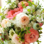Spring bridal bouquet at its best with ranunculus, anemones, poppy pods, spirea, and peonies.