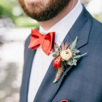 April boutonniere for a dashing groom