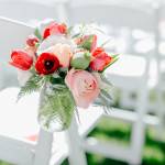 Aisle jars bring color to a spring wedding