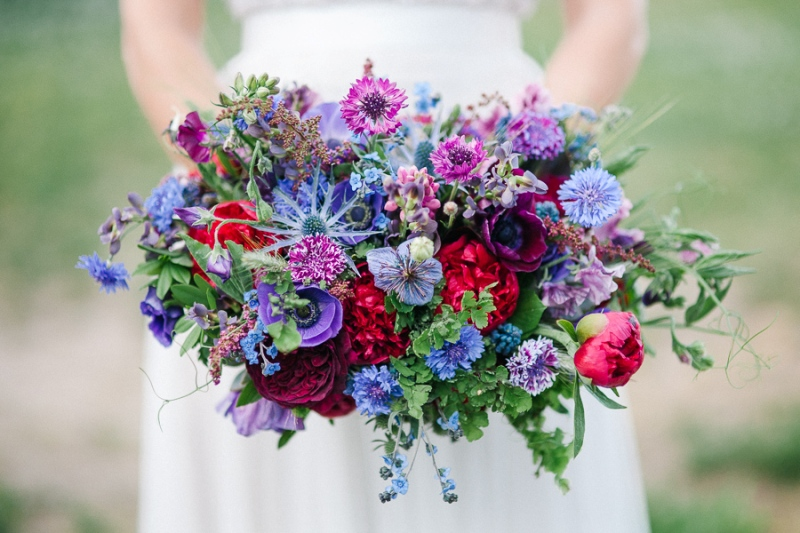 Bridal bouquet designed by Love 'n Fresh Flowers featuring Ultra Violet.